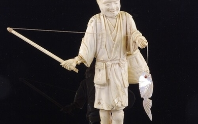 A Japanese ivory okimono depicting a fisherman with a mother...