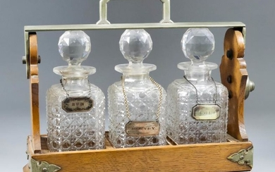 A Late Victorian Oak and Plated Metal Three Bottle...