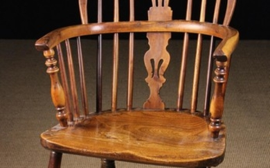A Low Back Yew-wood Windsor Armchair having a burr-figured back hoop and bow. The pierced upper & lo