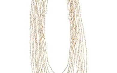 A MULTI STRAND PEARL NECKLACE; 12 strands of seed pearls to silver gilt chain and clasp, 42cm.