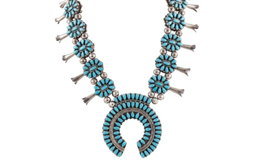 A NATIVE AMERICAN NAVAJO INDIAN NECKLACE, set with turquoise...