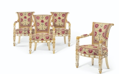 A SET OF FOUR EMPIRE WHITE-PAINTED AND PARCEL-GILT FAUTEUILS, CIRCA 1810, THE UPHOLSTERY SUPPLIED BY RENZO MONGIARDINO