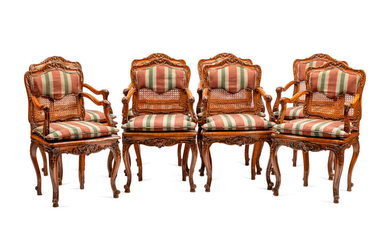A Set of Eight Louis XV Style Carved Walnut Dining Chairs