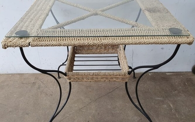 A WROUGHT IRON AND WOVEN SEAGRASS OUTDOOR TABLE