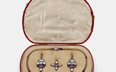 A demi parure comprising a necklace, a pair of earrings and a pendant