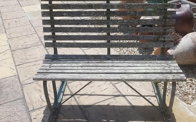 A garden bench, with cast metal ends.