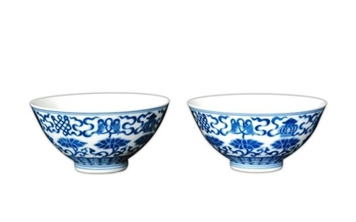 A pair of Chinese 'Buddhist emblem' blue and white bowls, Qi...