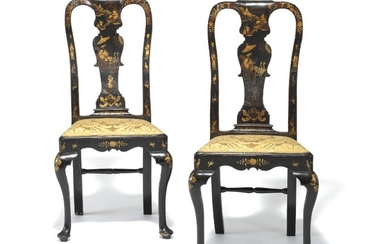 A pair of George II black lacquer and gold japanned side chairs, each with arched backs, drop-in seats and cabriole legs. Mid-18th century. (2)