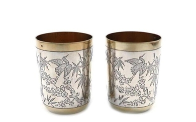 A pair of Victorian parcel-gilt silver Aesthetic movement...