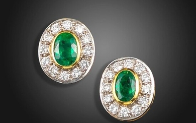A pair of emerald and diamond cluster earrings, the oval-shaped emeralds are set within a surround of round brilliant-cut diamonds in platinum and gold, 13mm high, case