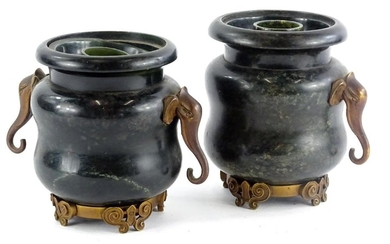 A pair of hardstone vases, with elephant mask handles and ca...