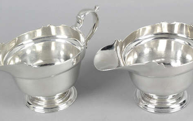 A pair of silver sauce boats.