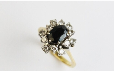 A sapphire and diamond cluster ring, comprising a central ov...