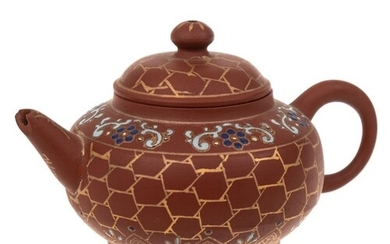 A small Chinese Yixing stoneware teapot: of light brown hue ...