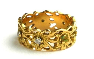 AN 18CT GOLD AND DIAMOND RING The pierced decoration of orga...