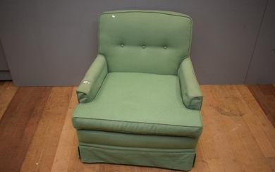 AN UPHOLSTERED LOUNGE CHAIR