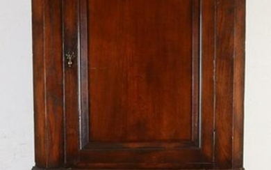 Antique English two-part oak corner cabinet with two