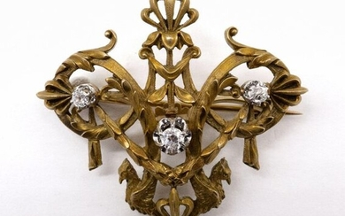 BROCHE STYLE EMPIRE en or jaune 18K présentant...