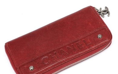 Chanel: A wallet made of dark red Caviar leather with silver toned hardware, one zipped...