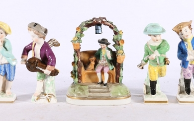 English porcelain figure group of a man and dog in arbour, g...