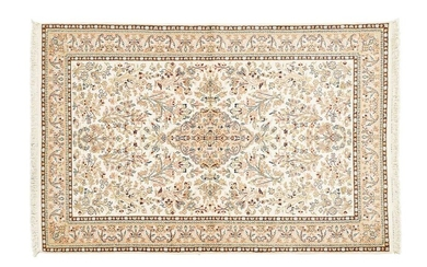 Fine Silk Kashmir ( India ) circa 1985 Dimensions. 185 x 124 cm Technical specifications. Silk velvet on cotton foundations Good condition Beige field with plants and flower strands framing a central old gold floral medallion in the shape of a stylized...