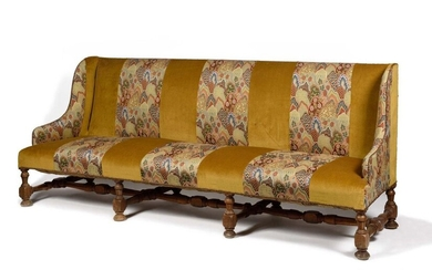 Large walnut winged sofa, the base turned with balusters and spacers, covered with velvet and tapestry strips to the point. 19th century. H : 102 cm, W : 242 cm Provenance : Château de La Roche-Guyon