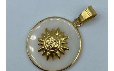 Mother of pearl pendant with sun design set in 18k yellow go...