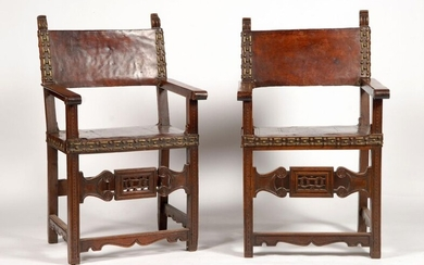 Pair of natural wood armchairs upholstered with leather and nails....