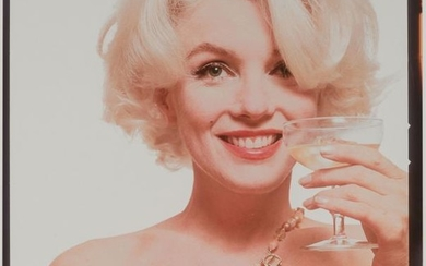 STERN, BERT (1929-2013) Marilyn Monroe with cocktail glass,
