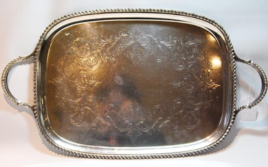 Silver tray of bowed rectangular shape with engraved scrolls...