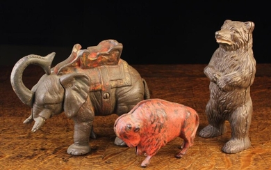 Three Early 20th Century Cast Iron Animal Money Banks: An American mechanical bank by Hubley Manufac