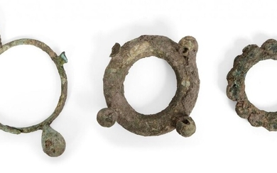 Three large Chinese bronze bracelets, Neolithic period, each cast with...
