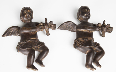 Two carved and stained wooden figures of cherubs, probably 19th century, each holding a bird, height