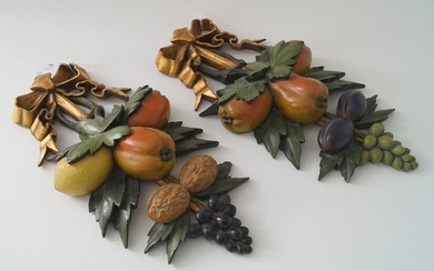 Two polychrome wooden wall ornaments, a.o. decorated with fruit, painted by Paul Citroen, l. 34 cm (2x)