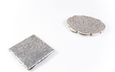 Two silver powder compacts