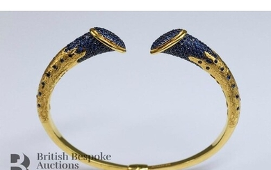 A 22ct yellow gold and sapphire torque bangle, mm ATASAY 916...