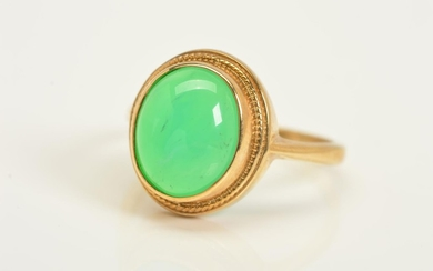A 9CT GOLD GEM RING, designed as an oval chrysoberyl cabocho...