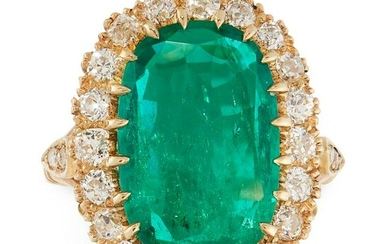 A COLOMBIAN EMERALD AND DIAMOND CLUSTER RING in yellow