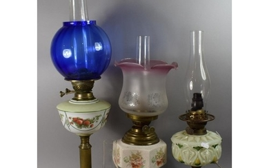 A Collection of Three Oil Lamps, One Converted to Electricit...