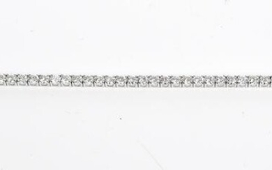 A DIAMOND LINE BRACELET IN 18CT WHITE GOLD, THE DIAMONDS TOTALLING 7.05CTS, TOTAL LENGTH 18.5CM, 9.2GMS