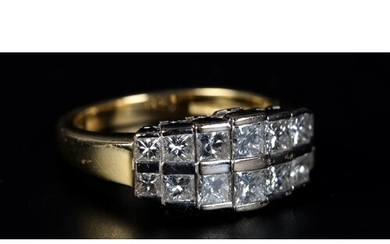 A DIAMOND RING in 18ct yellow and white gold, the graduated ...