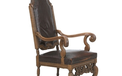 A Danish Baroque style oakwood armchair with leather cover. Early 20th century.