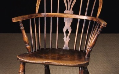 A Low Back Windsor Armchair having a yew-wood back hoop and bow. The pierced upper & lower centre sp
