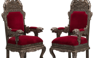 A Pair of Colonial Silver Repoussé Clad Throne Chairs