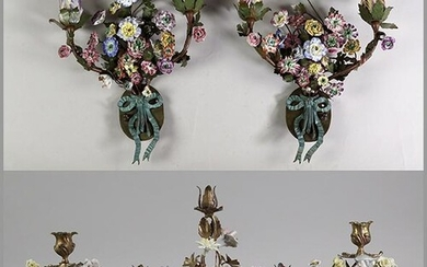 A Pair of French Gilt Metal and Porcelain Sconces.