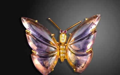 A diamond and gem-set gold butterfly ring by Geoffrey Rowlandson, with carved ametrine wings, a diamond-set throax and ruby eyes in 18ct gold, maker's mark, London hallmarks for 2005, size L Geoffrey Rowlandson was born in 1931 into a family of fashion...