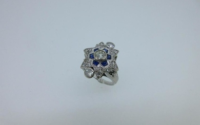 A diamond and sapphire star ring,