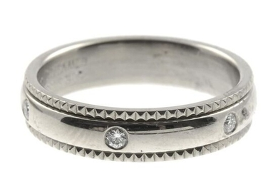 A diamond band ring.Total diamond weight 0.12ct, stamped...