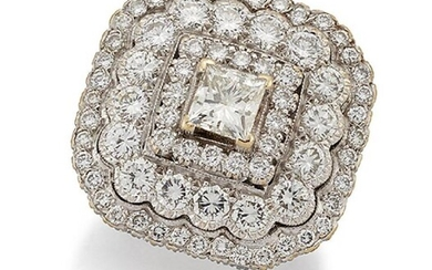 A diamond cluster ring, the princess-cut diamond...