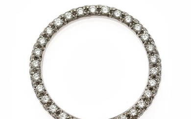 A diamond eternity ring set with numerous brilliant-cut diamonds weighing a total of app. 0.90...